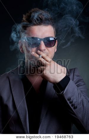 Mann Smoking A Cigarette