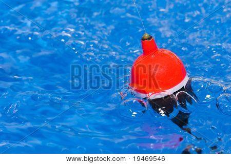 Fishing float in turbulent water