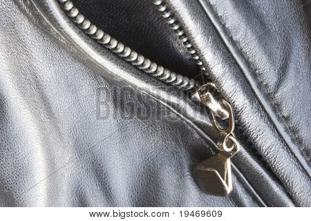 Close-up of a leather jacket with zipper