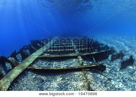 A shallow shipwreck under sun rays