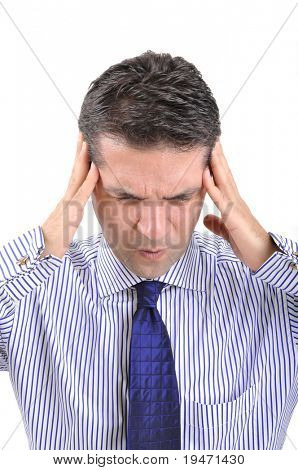 Businessman with severe migraine headache holding his head in his hands to head