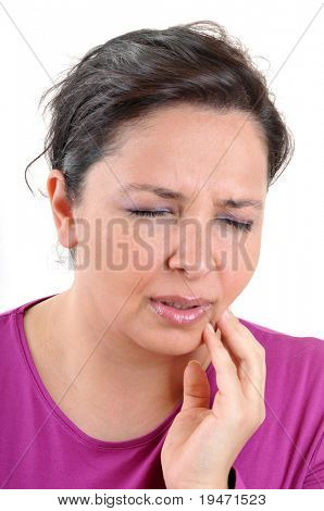 Young woman with toothache and painful face. White background vertical studio picture.