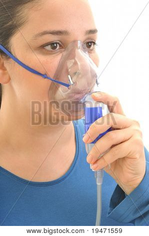 Close up image of a young woman with asthma using oxygen mask. White background, vertical,  studio picture