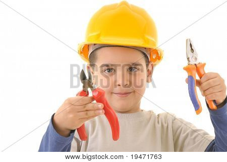 Little kid as a construction worker wearing yellow helmet with pliers in his hands. White background studio picture.