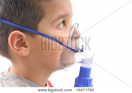 Close up image of a cute boy with respiratory problem or asthma. White background studio picture.