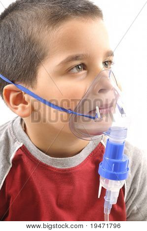 Close up image of a little boy with asthma using oxygen mask. White background studio picture