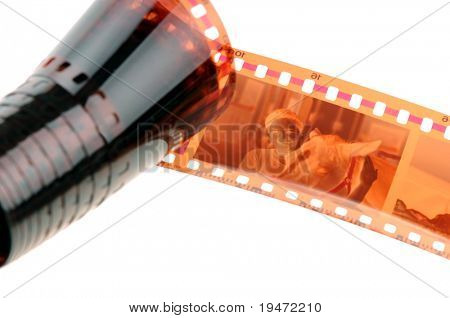 High resolution white background macro studio image of a 35 mm filmstrip