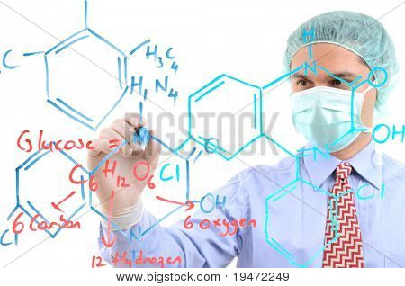 White background studio image of a medical researcher writing formula on glass. Focused on hand, face out of focus