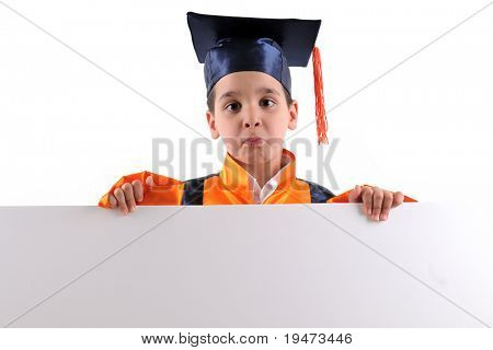 Cute boy in graduation uniform holding a blank board to write whatever you want.