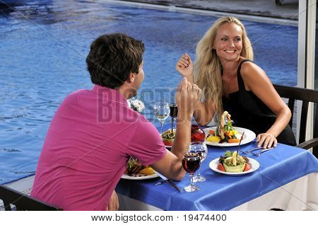 An attractive young woman on romantic date with her sweetheart - a series of RESTAURANT images.