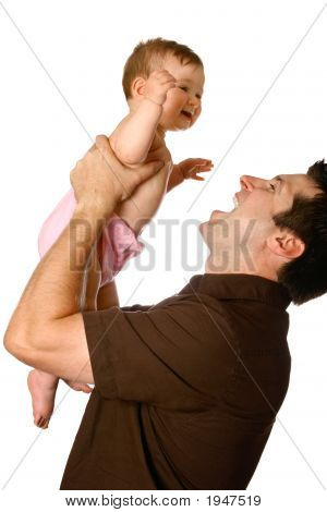 Chuckling Baby Lifted By Father
