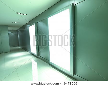 Blank billboard in modern building