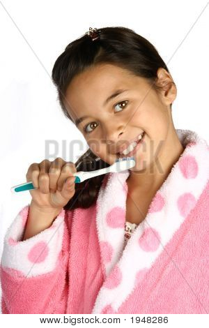 Young Girl With Toothbrush In Hand