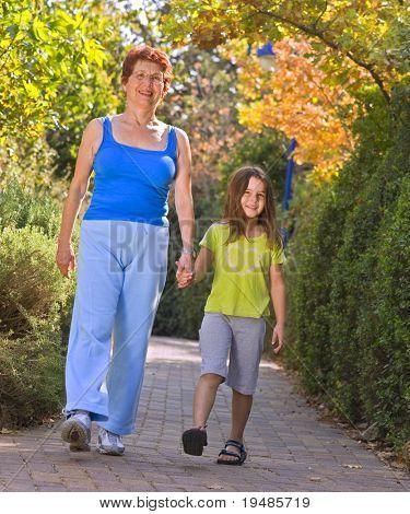 senior women exercise walking with grandchild