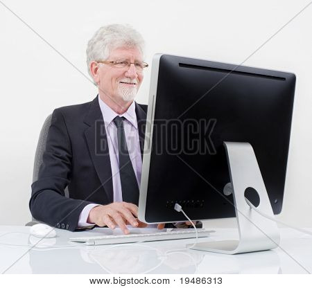 senior businessman with computer over white