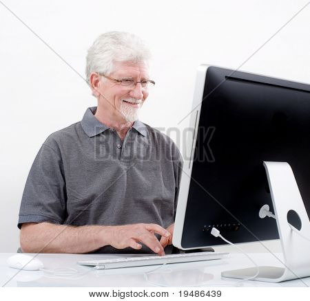 senior man with  computer at home