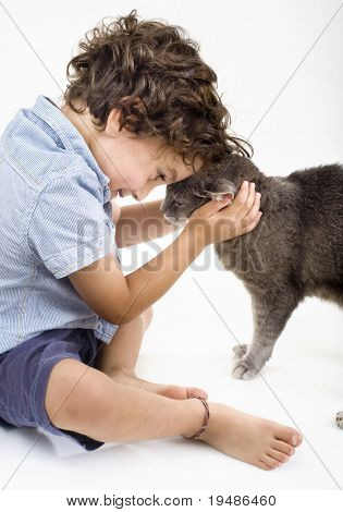 young boy playing with a gray cat