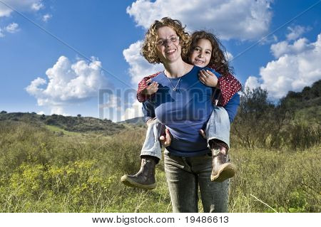 Mix race mother and child having fun outdoors