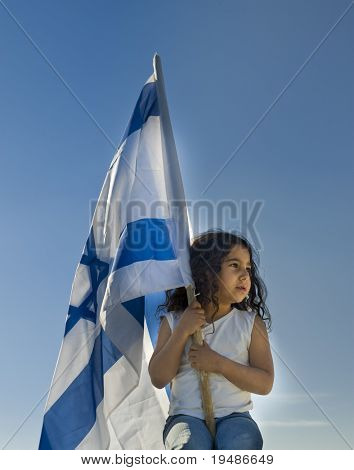 little girl holding the Israeli flag