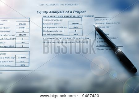 Analysis spreadsheet with pen pointing and cloud background