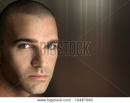 Close up horizontal portrait of a young good looking man with lots of copyspace