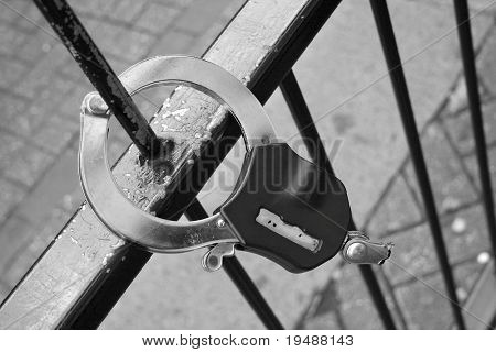 Handcuffs broken on a fencing.  A street of the large city.