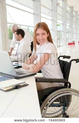 Handicapped woman in office