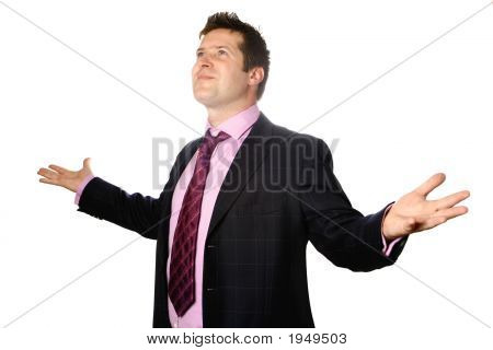 Businessman With Both Arms Open Wide Looking Up