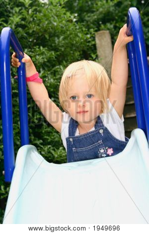 Girl Toddler Climbing Up The Slide