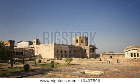 Group of people enjoying in courtyard of Lahore Fort with ancient building in background Pakistan