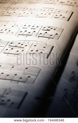 Closeup of old music sheet, dual-toned.