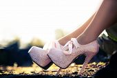 stock photo of stiletto  - Close up of a pink high heels with little diamonds - JPG
