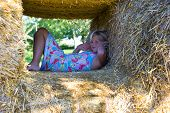 Cute Girl On Haybales poster