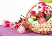 picture of goodies  - Basket full of Easter eggs  and tilips - JPG
