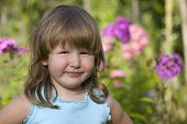 Portrait Of Little Smiling Girl Outdoors poster
