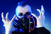 stock photo of skinhead  - Shot of a conceptual man in a respirator - JPG