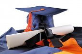 picture of graduation cap  - Graduation cap and diploma isolated on a white background - JPG