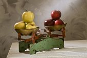 old scales with yellow and red apples isolated on white