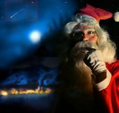 stock photo of santa claus hat  - Nostalgic magical portrait of Santa Claus at the North Pole - JPG
