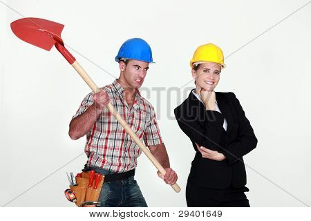 Construction worker preparing to hit an engineer over the head