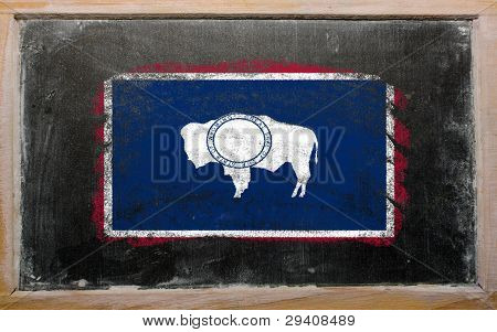 Flag Of Us State Of Wyoming On Blackboard Painted With Chalk