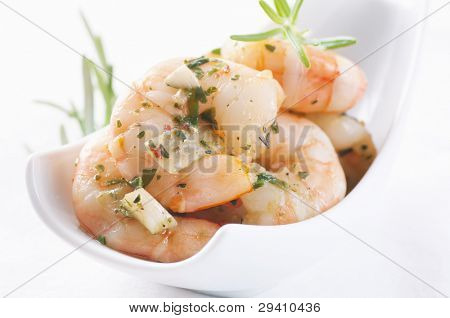 Pickled prawns in olive oil with herbs and garlic