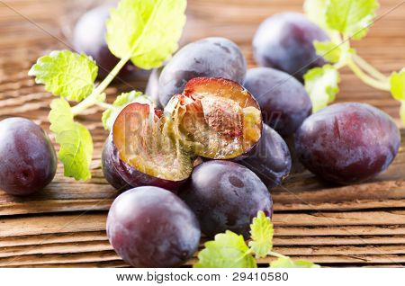 Fresh Plums on the wooden table