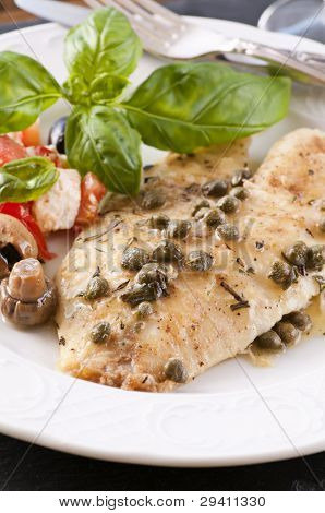 Fish piccata with salad