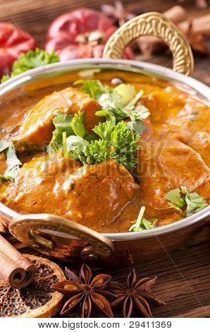 fish curry in brass pot