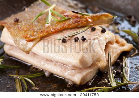 trout fried in the iron pan with herbs