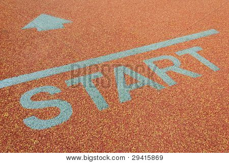 Athlete track start sign with arrow