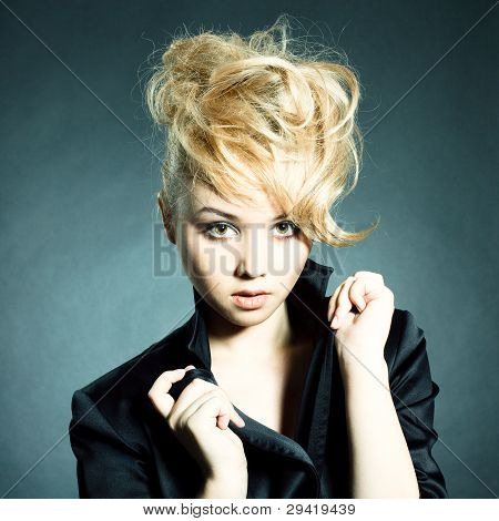 Fashion Portrait Of Beautiful Young Woman Posing On Black Background