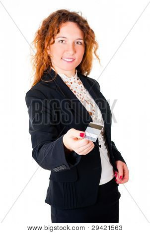 Happy satisfied business woman holds out her credit card isolated on white background. Focus to the card, not to face