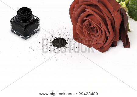 Red Rose And Ink Pot On Paper